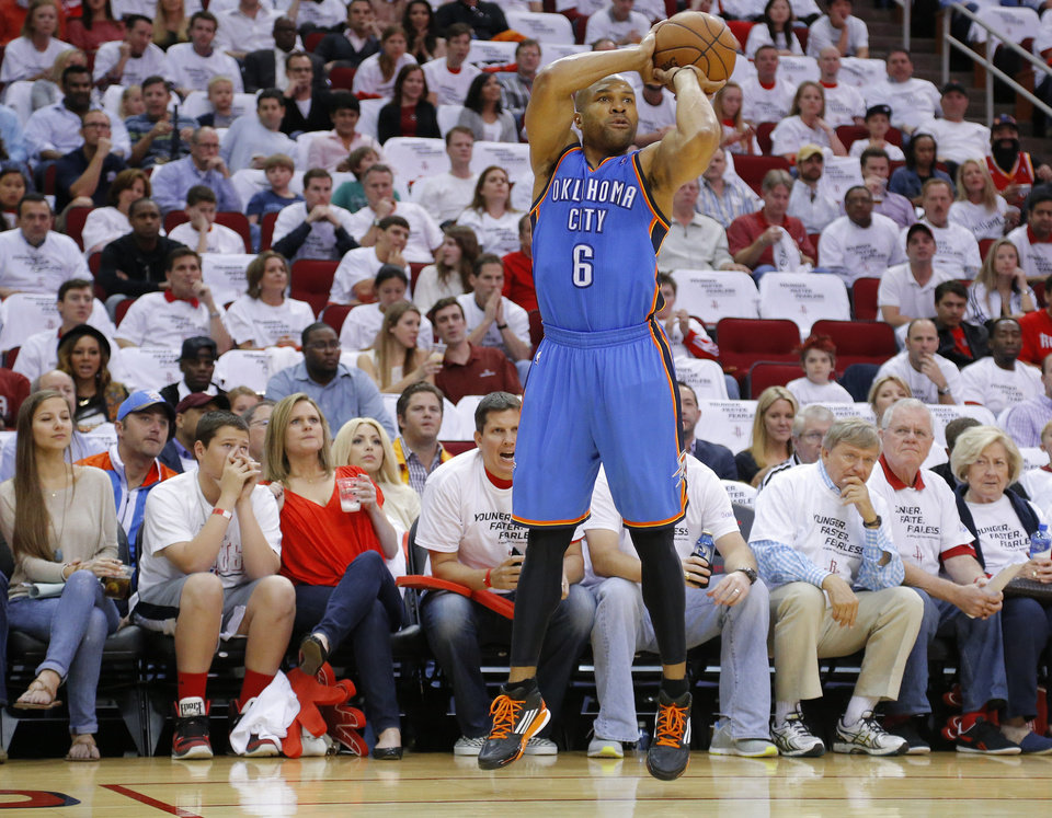 Oklahoma City's Derek Fisher (6) shoots the ball during Game 3 in the first round of the NBA playoffs between the Oklahoma City Thunder and the Houston Rockets at the Toyota Center in Houston, Texas, Sat., April 27, 2013. Oklahoma City won 104-101. Photo by Bryan Terry, The Oklahoman
