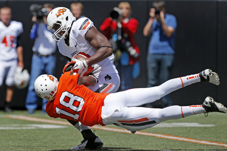 Oklahoma State's Deion Imade pulls the ball away from Blake Jackson for an incompletion during OSU's spring football game at Boone Pickens Stadium in Stillwater, Okla., Sat., April 20, 2013. Photo by Bryan Terry, The Oklahoman