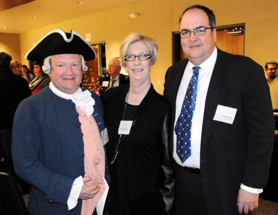 Chip Oppenheim, Marion and Craig Story enjoyed the activities that the Oklahoma Foundation for Excellence, The Colonial Williamsburg Foundation and the Oklahoma History Center hosted to celebrate the 20th anniversary of Oklahoma?s Colonial Williamsburg Teacher Institute Program. The events included Colonial Day at the Capitol for fifth grade students, an afternoon teacher workshop and an evening reception and dinner at the Oklahoma History Center. Marion Story is the daughter of the late Oklahoma City businessman Edward C. Joullian III, who began the partnership between Williamsburg and the Foundation for Excellence. For 20 years, the Joullian family has overseen the fundraising efforts for fellowships for teachers to attend the annual Colonial Williamsburg Teacher Institute. The celebration dinner was held at the Oklahoma History Center (Photo by David Wheelock).