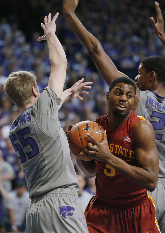 Iowa State forward Melvin Ejim (3) gets called for traveling while covered by Kansas State guard Will Spradling (55) during the first half of an NCAA college basketball game in Manhattan, Kan., Saturday, Feb. 9, 2013. (AP Photo/Orlin Wagner)