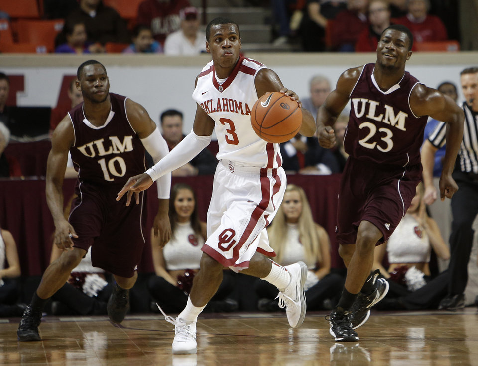 Oklahoma's Buddy Hield (3) runs the ball downcourt from Louisiana's Amos Olatayo (10) and Millaun Brown (23) during a men's college basketball game between the University of Oklahoma and the University of Louisiana-Monroe at the Loyd Noble Center in Norman, Okla., Sunday, Nov. 11, 2012.  Photo by Garett Fisbeck, The Oklahoman