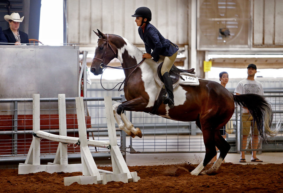 Photo -  Brittney Taylor rides Mosaic in the Working Hunter Class during the Cleveland County Free Fair Horse Show. PHOTO BY STEVE SISNEY, THE OKLAHOMAN   STEVE SISNEY -