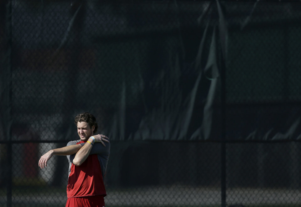 Photo - St. Louis Cardinals pitcher Kevin Siegrist stretches during an informal spring training baseball practice Wednesday, Feb. 12, 2014, in Jupiter, Fla. Cardinals pitchers and catchers first official practice is scheduled for Thursday. (AP Photo/Jeff Roberson)