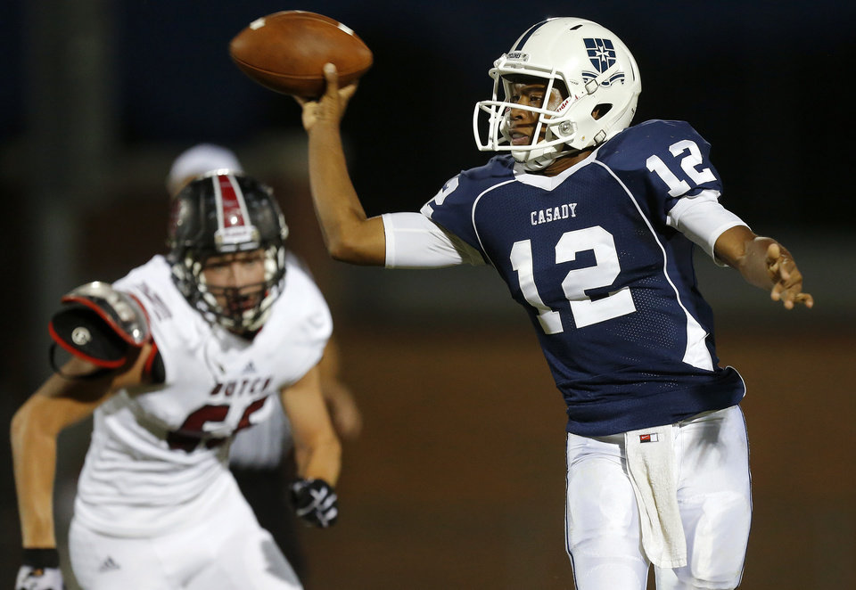 Photo - Casady's T'Quan Wallace throws a pass against Holland Hall during their high school football game at Casady in Oklahoma City, Friday, August 30, 2013. Photo by Bryan Terry, The Oklahoman