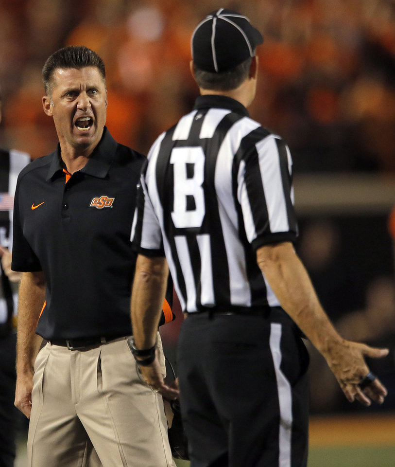 Photo - Oklahoma State head coach Mike Gundy argues a call during a college football game between Oklahoma State University (OSU) and the University of Texas (UT) at Boone Pickens Stadium in Stillwater, Okla., Saturday, Sept. 29, 2012. Texas on 41-36. Photo by Sarah Phipps, The Oklahoman