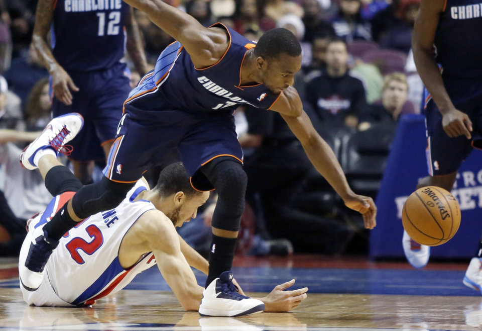 Photo - Charlotte Bobcats guard Kemba Walker, front, steals the ball from Detroit Pistons forward Tayshaun Prince (22) in the first half of an NBA basketball game, Sunday, Jan. 6, 2013, in Auburn Hills, Mich. (AP Photo/Duane Burleson)