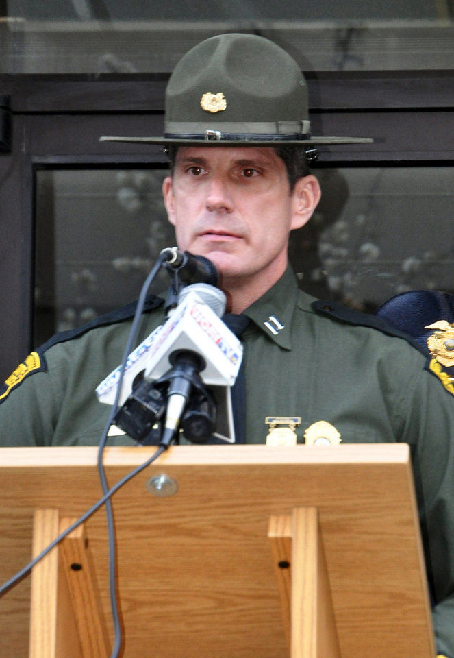 West Virginia State Police Capt. David Nelson speaks at a news conference about the fatal shooting of Mingo County Sheriff Eugene Crum, Wednesday, April 3, 2013 in Williamson, W.Va. (AP Photo/Williamson Daily News, Kyle Lovern) MANDATORY CREDIT