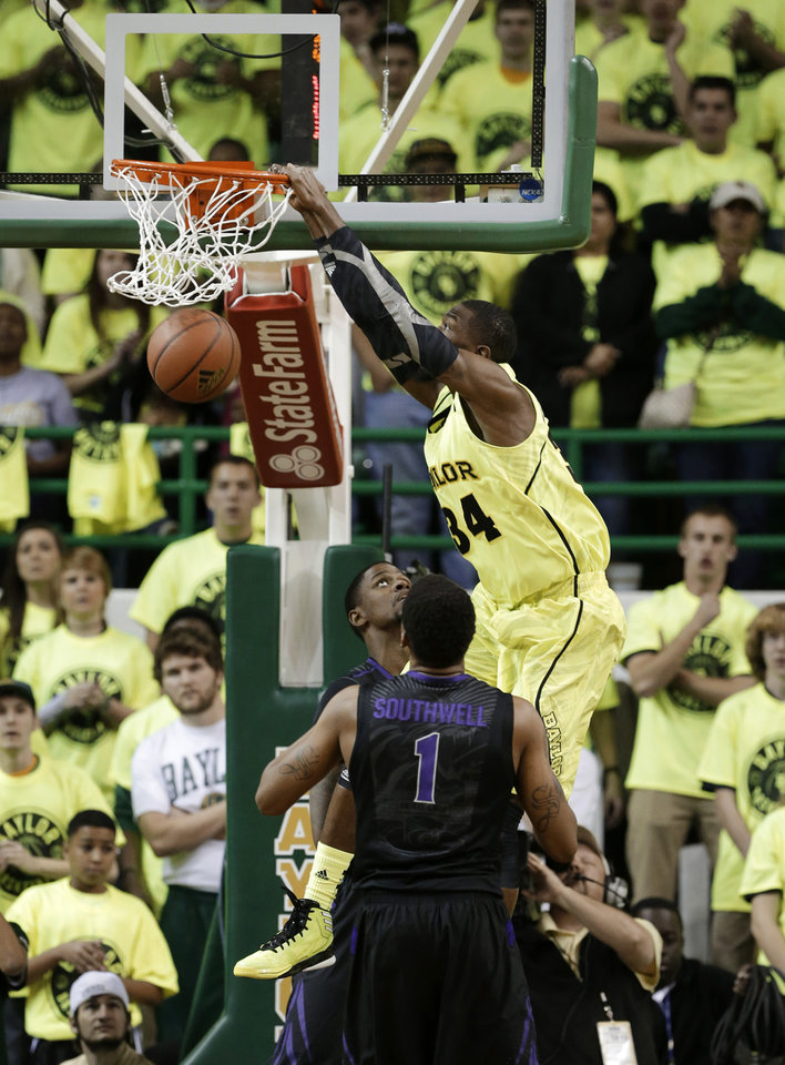 Baylor's Cory Jefferson (34) dunks over Kansas State's Shane Southwell (1) and Jordan Henriquez in the first half of an NCAA college basketball game on Saturday, March 2, 2013, in Waco, Texas. (AP Photo/Tony Gutierrez)