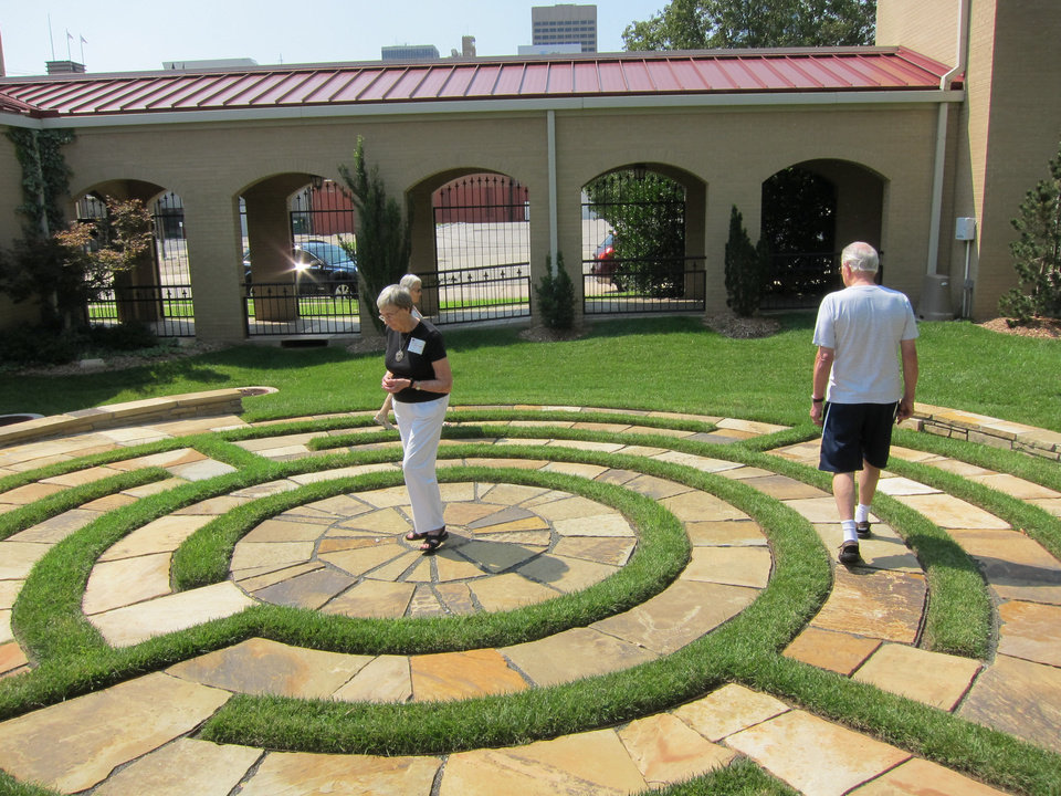 Photo - Church members Joyce Gibb and Malcolm May walk the four-circuit labyrinth created three years ago in the east garden of St. Paul's Episcopal Cathedral, 127 NW 7. PHOTO BY CARLA HINTON, THE OKLAHOMAN  Carla Hinton - The Oklahoman