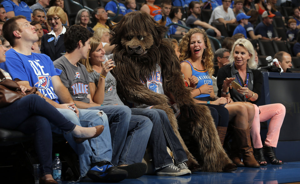 Photo - Rumble joins fans during the preseason NBA game between the Oklahoma City Thunder and the Charlotte Bobcats at Chesapeake Energy Arena in Oklahoma City, Tuesday, Oct. 16, 2012. Photo by Sarah Phipps, The Oklahoman