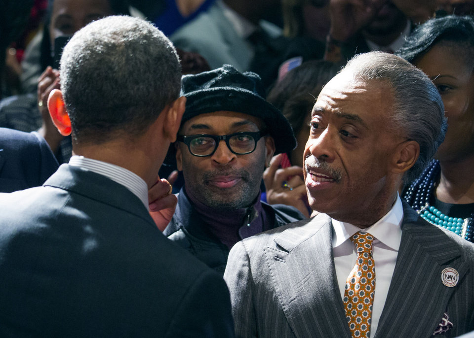 Photo - President Barack Obama greets film director, producer, writer, and actor Spike Lee, left,  and Rev. Al Sharpton, Friday, April 11, 2014, at the National Action Network conference, in New York. (AP Photo/Newsday, Craig Ruttle, Pool)