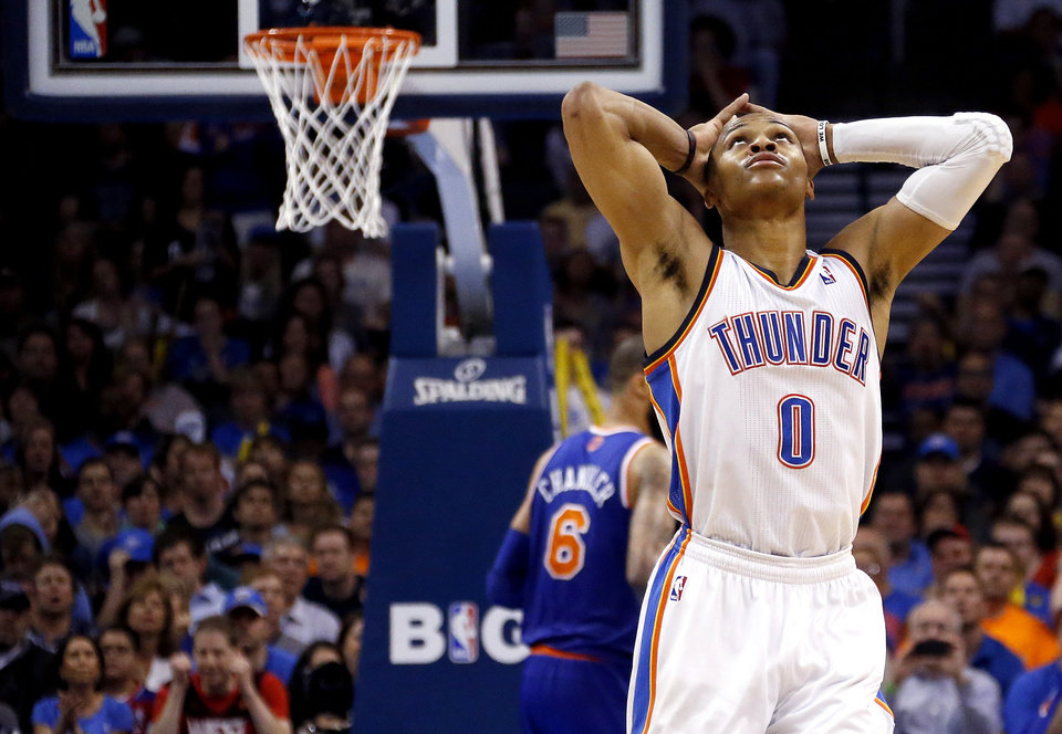 Photo - Oklahoma City's Russell Westbrook (0) reacts after missing a shot during NBA basketball game between the Oklahoma City Thunder and the New York Knicks at the Chesapeake Energy Arena, Sunday, April 7, 2010, in Oklahoma City Photo by Sarah Phipps, The Oklahoman