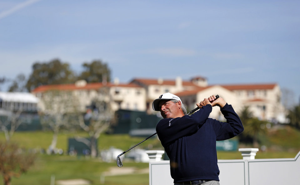 Photo - Fred Couples watches his shot from the 14th tee in the pro-am of the Northern Trust Open golf tournament at Riviera Country Club in the Pacific Palisades area of Los Angeles on Wednesday, Feb. 12, 2014. (AP Photo/Reed Saxon)