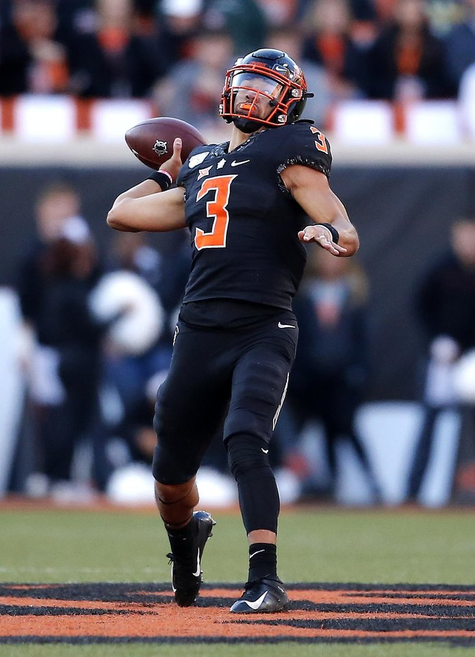 Photo - Oklahoma State's Spencer Sanders (3) throws the ball in the fourth quarter during the college football game between the Oklahoma State University Cowboys and the TCU Horned Frogs at Boone Pickens Stadium in Stillwater, Okla.,  Saturday, Nov. 2, 2019. OSU won 34-27. [Sarah Phipps/The Oklahoman]