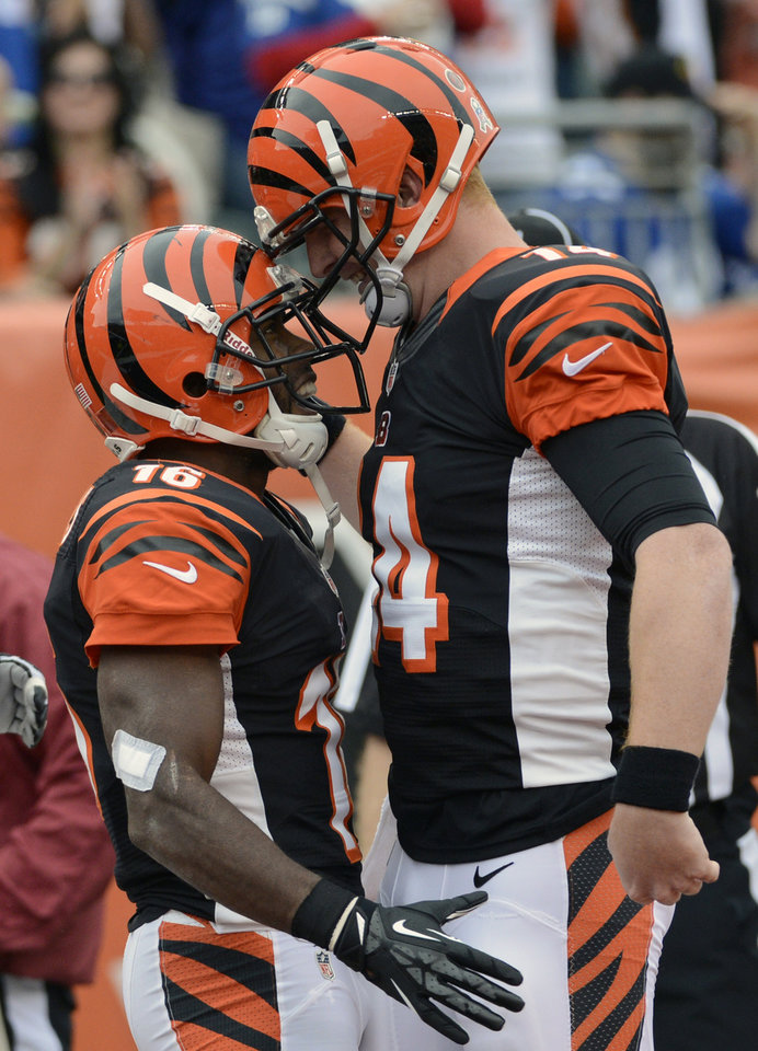 Photo -   Cincinnati Bengals quarterback Andy Dalton (14) bumps helmets with wide receiver Andrew Hawkins after they connected on an 11-yard touchdown pass in the first half of an NFL football game against the New York Giants, Sunday, Nov. 11, 2012, in Cincinnati. (AP Photo/Michael Keating)