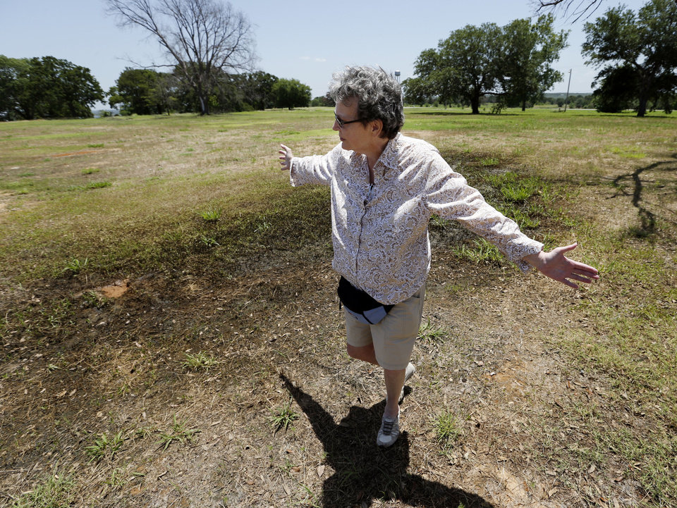 TEXHOMA LAKE DEVELOPMENT: Lisa Davis shows the former entrance to Lake Texhoma Lodge where a delay on construction of a new hotel has residents angry on Wednesday, June 12, 2013 in Kingston, Okla.  Photo by Steve Sisney, The Oklahoman