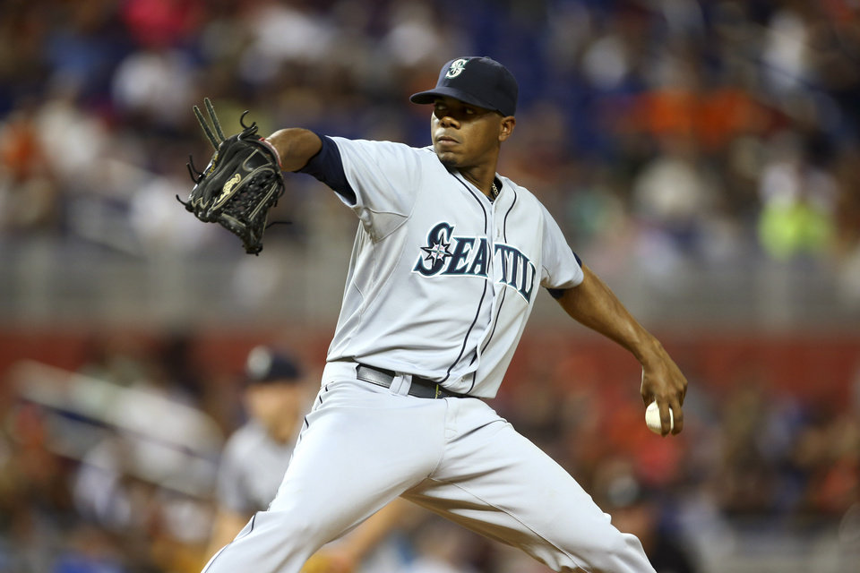 Photo - Seattle Mariners starter Roenis Elias throws to the Miami Marlins during the first inning of a baseball game in Miami, Saturday, April 19, 2014. (AP Photo/J Pat Carter)