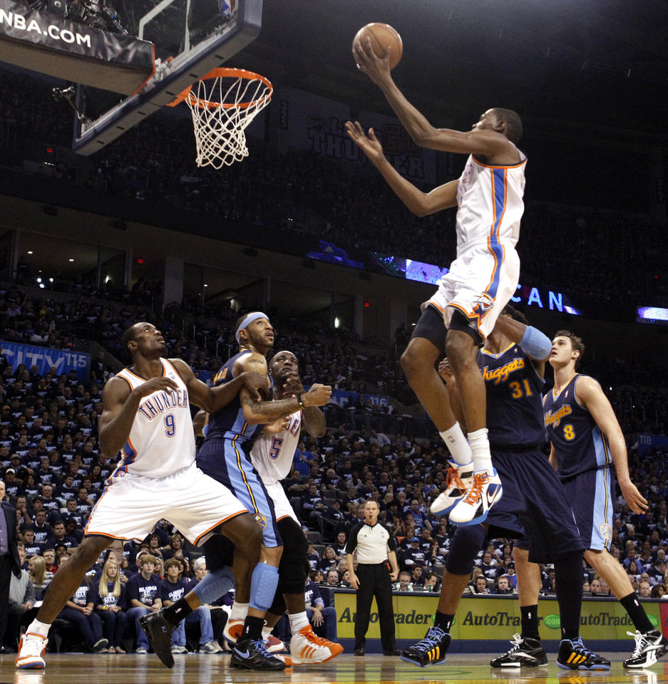Oklahoma City's Kevin Durant (35) shoots  the NBA basketball game between the Denver Nuggets and the Oklahoma City Thunder in the first round of the NBA playoffs at the Oklahoma City Arena, Wednesday, April 27, 2011. Photo by Sarah Phipps, The Oklahoman