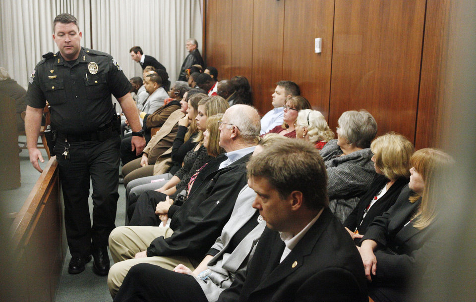 A courtroom packed with parole officers and family members of the victim and defendant attends the preliminary hearing Friday for Lester Kinchion Jr. at the Oklahoma County Courthouse in Oklahoma City.  Photo by Paul B. Southerland, The Oklahoman