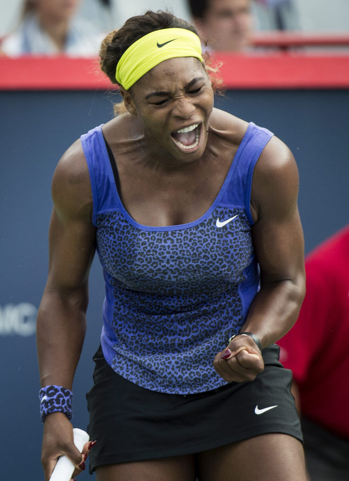 Photo - Serena Williams, of the United States, reacts after winning a point against Lucie Safarova, of the Czech Republic, at the Rogers Cup tennis tournament, Thursday, Aug. 7, 2014, in Montreal. (AP Photo/The Canadian Press, Paul Chiasson)