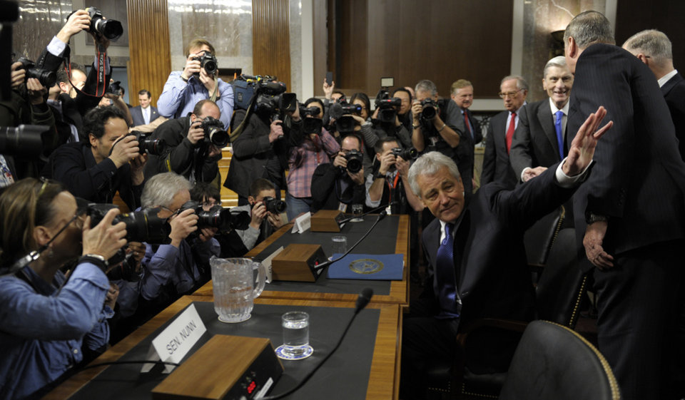Former Nebraska Republican Sen. Chuck Hagel, President Barack Obama's choice for defense secretary, waves as he arrives on Capitol Hill in Washington, Thursday, Jan. 31, 2013, to testify before the Senate Armed Services Committee hearing on his nomination.  (AP Photo/Susan Walsh)