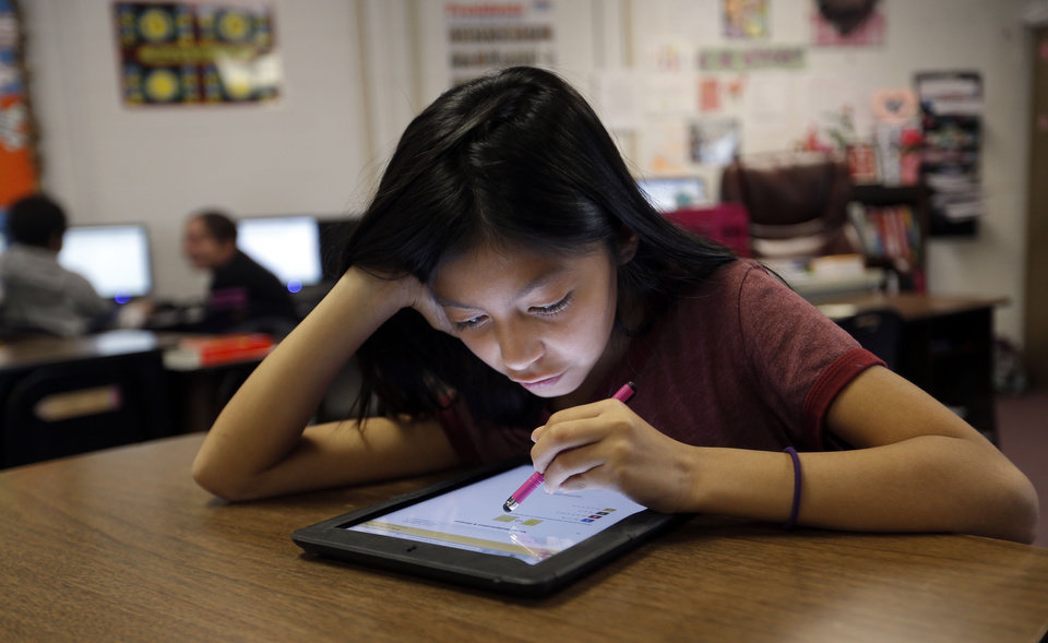 Photo - Aliyah Harjochee works on an iPad at Ryal Public School, Wednesday, Feb. 13, 2013. Photo by Sarah Phipps, The Oklahoman