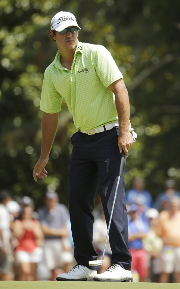 Photo - Brooks Koepka reacts after missing a putt on the first hole during the third round of the U.S. Open golf tournament in Pinehurst, N.C., Saturday, June 14, 2014. (AP Photo/Chuck Burton)