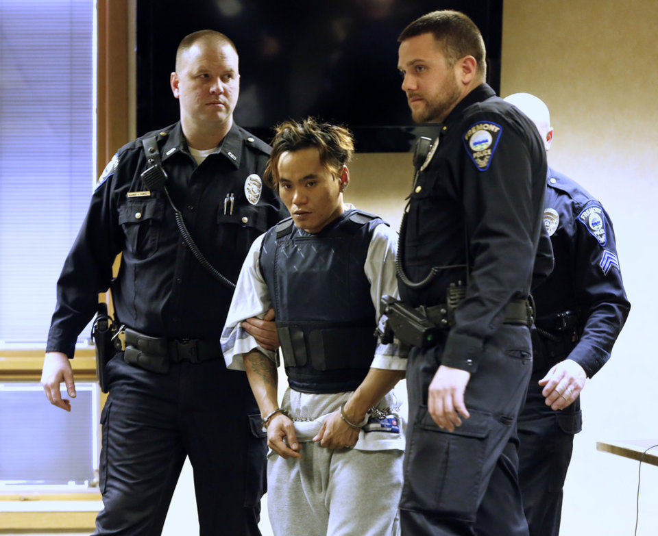 Photo - Igmidio Mista appears in Fremont Municipal Court, Monday, March 10, 2014, in Fremont, Ohio. He is charged with shooting and killing three people in a Fremont bar early Sunday morning. (AP Photo/The Blade, Jetta Fraser)  MANDATORY CREDIT; MAGS OUT; NO SALES; TV OUT; SENTINEL-TRIBUNE OUT; MONROE EVENING NEWS OUT; TOLEDO FREE PRESS OUT