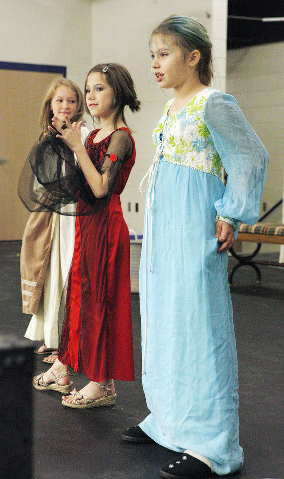 Fourth-graders Asher Bartlett as Cinderella, Gwenyth Green as the stepmother and Morgan Jones as Drizella perform in �Cinderella.�