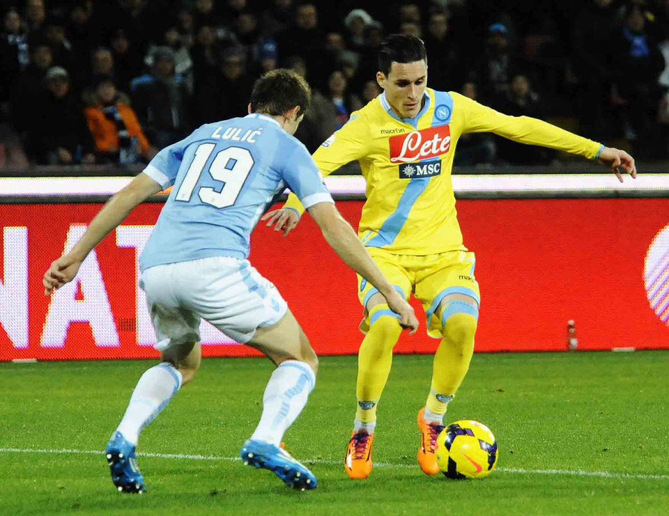Photo - Napoli's José Callejón, right, and Lazio's  Senad Lulic, vie for the ball during an Italian Cup Cup quarterfinal soccer match between Napoli and Lazio, at the San Paolo stadium in Naples, Italy, Wednesday, Jan. 29, 2014. (AP Photo/Salvatore Laporta)