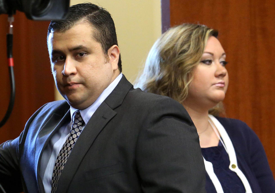 Photo - In this June 24, 2013 file photo, George Zimmerman, left, arrives in Seminole circuit court, with his wife Shellie, in Sanford, Fla. Shellie Zimmerman called police on Monday, Sept. 9, 2013, saying her husband threatened her and her dad with a gun. Zimmerman was acquitted in the 2012 shooting death of Trayvon Martin. (AP Photo/Orlando Sentinel, Joe Burbank, Pool, File)