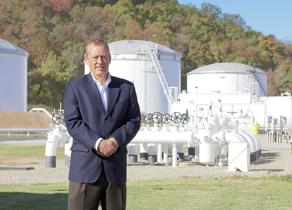 Magellan Midstream Partners CEO Mike Mears stands in front of gasoline and diesel storage tanks at the company's Tulsa terminal.
