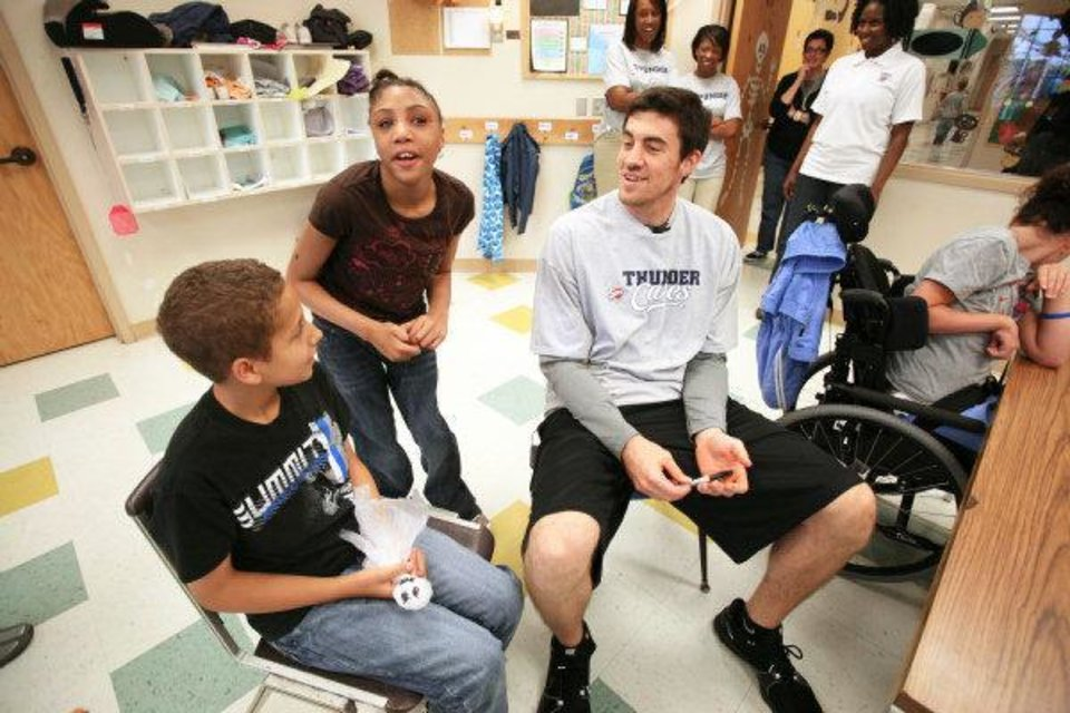 The Oklahoma City Thunder's Nick Collison talks to Zack Hardiman at Special Care. PHOTO PROVIDED <strong>J.P. Wilson/Icon SMI</strong>