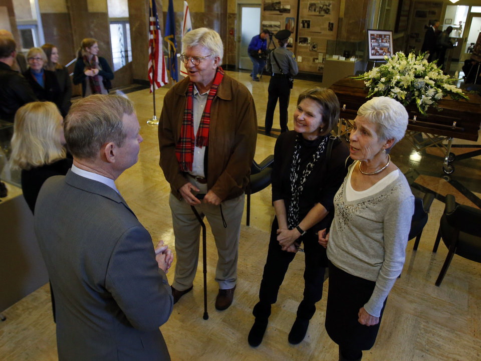 Photo - Latting children Jim Latting, Cynthia Weimer and Nancy Spelman talk with current Mayor Mick Cornett as the body of their mother, former Oklahoma City Mayor Patience Latting, lies in state at city hall on Thursday, Jan. 3, 2013  in Oklahoma City, Okla. Photo by Steve Sisney, The Oklahoman  STEVE SISNEY - THE OKLAHOMAN
