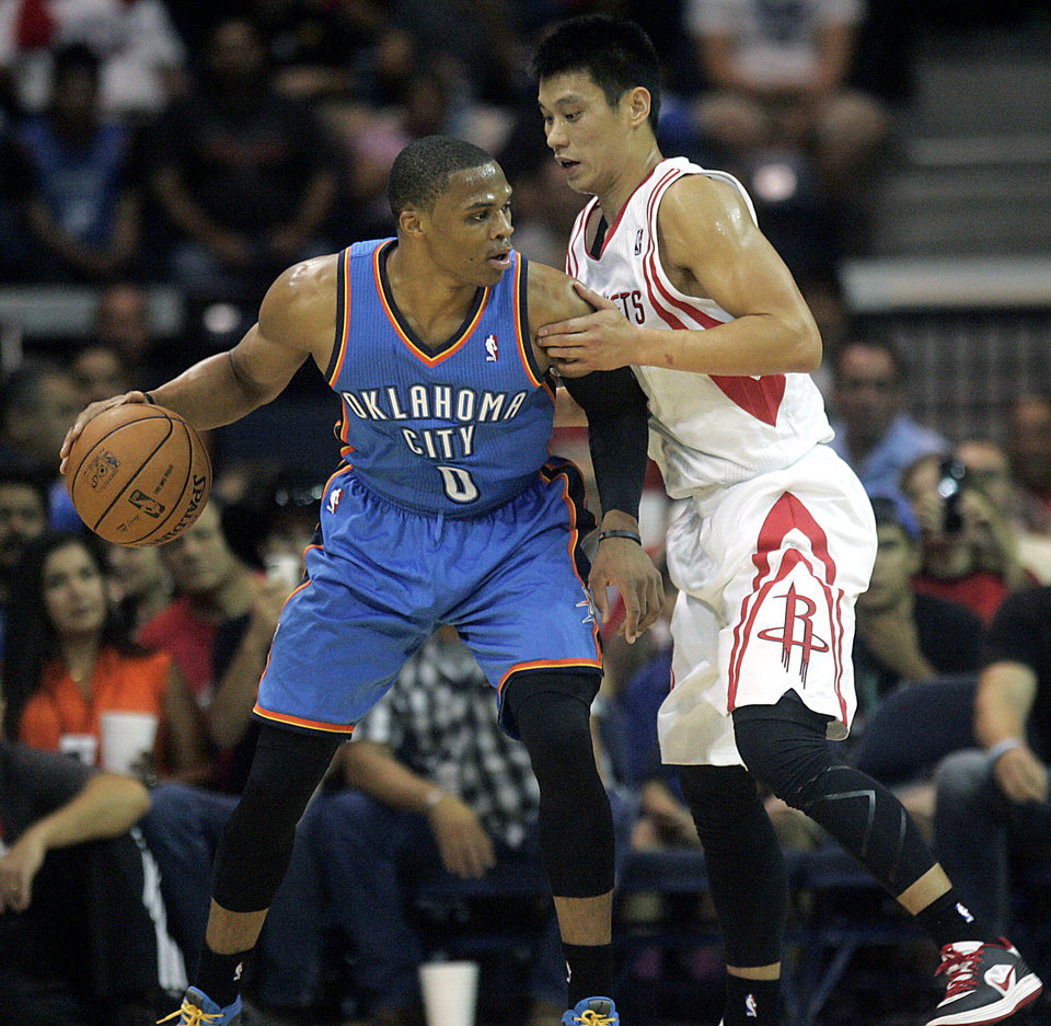Houston Rockets' Jeremy Lin defends Oklahoma City Thunder's Russell Westbrook (0) during the second quarter of an NBA preseason basketball game, Wednesday, Oct. 10, 2012, in Hidalgo, Texas. The Thunder won 107-103. (AP Photo/Delcia Lopez)