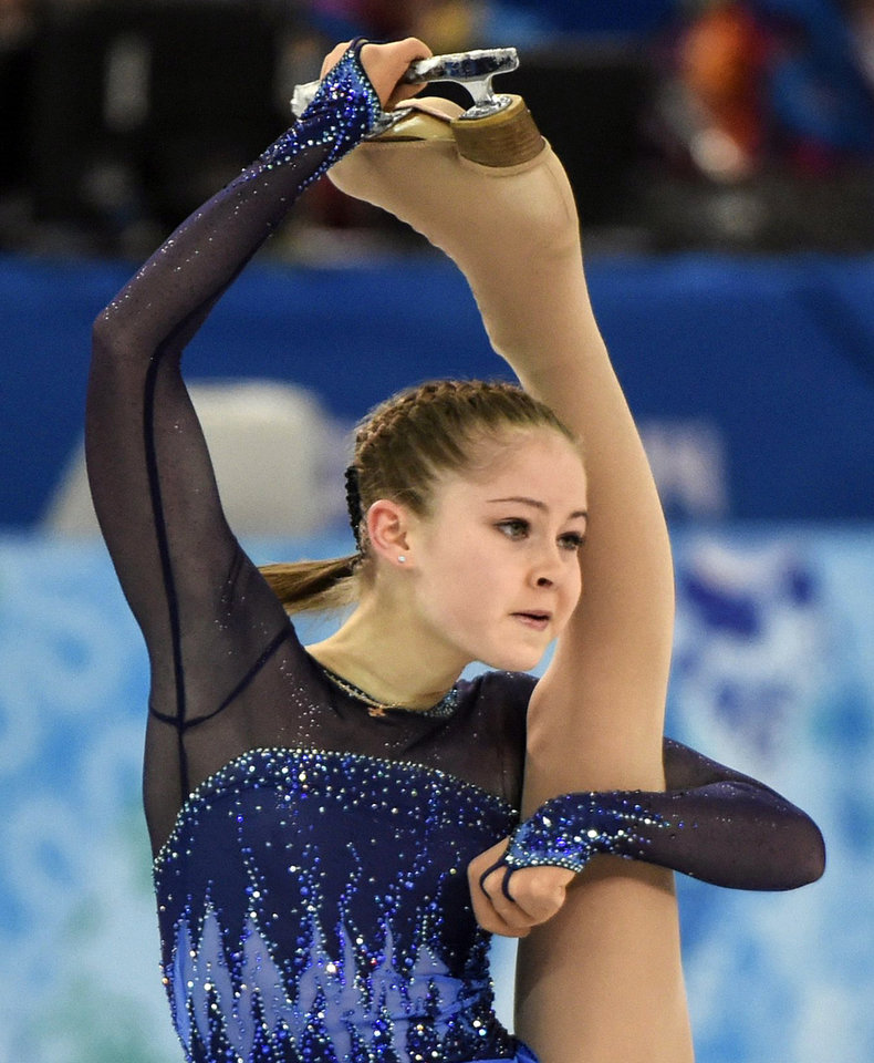 Photo - Yulia Lipnitskaya, of Russia, competes in the women's team short program figure skating competition at the Iceberg Skating Palace during the 2014 Winter Olympics, Saturday, Feb. 8, 2014, in Sochi, Russia. (AP Photo/The Canadian Press, Paul Chiasson)