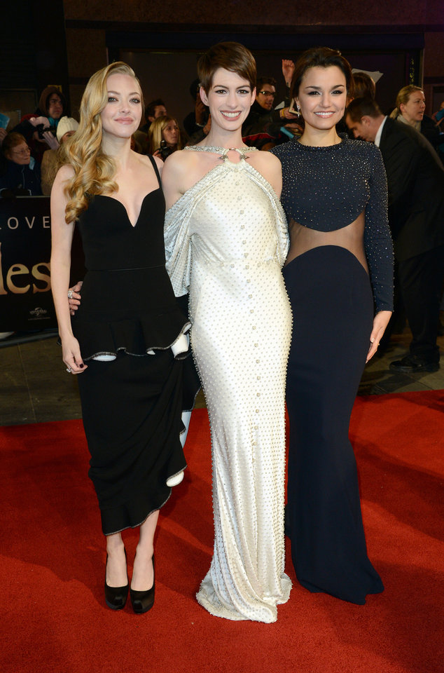 From left, actors Amanda Seyfried, Anne Hathaway and Samantha Barks pose for photographers as they arrive at the premiere of Les Miserables at a cinema in central London, Wednesday, Dec. 5, 2012. (Photo by Jon Furniss/Invision/AP)