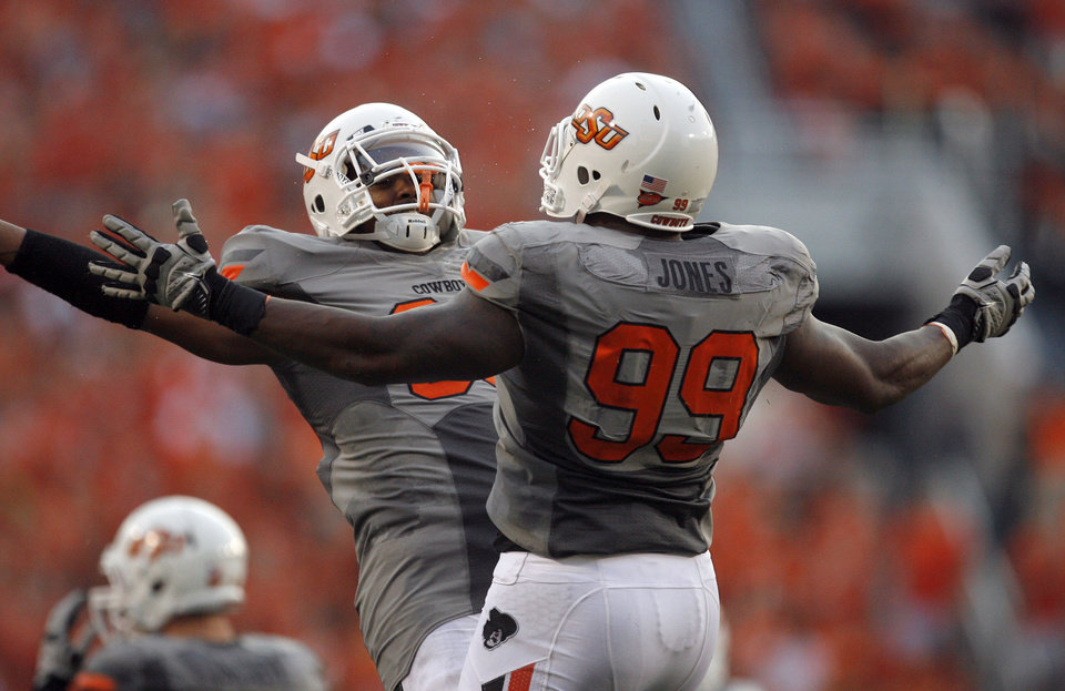 Photo - Oklahoma State's Wilson Youman, left, and Richetti Jones celebrate during the game Saturday. Photo by Sarah Phipps, The Oklahoman