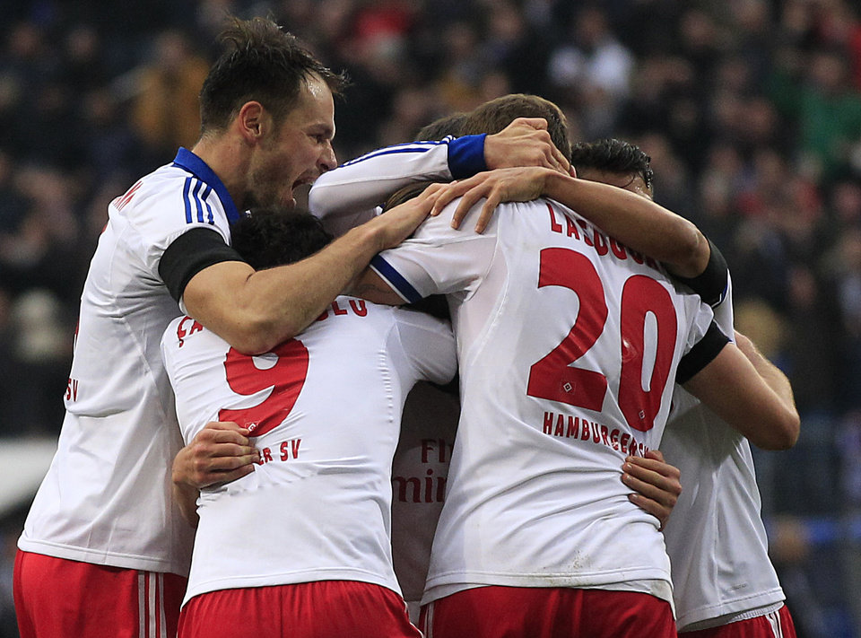 Photo - Hamburg's team celebrates after scoring challenge for the ball during the German first division Bundesliga soccer match between Hamburg SV and BvB Borussia Dortmund in Hamburg, Germany, Saturday, Feb. 22, 2014. (AP Photo/Frank Augstein)