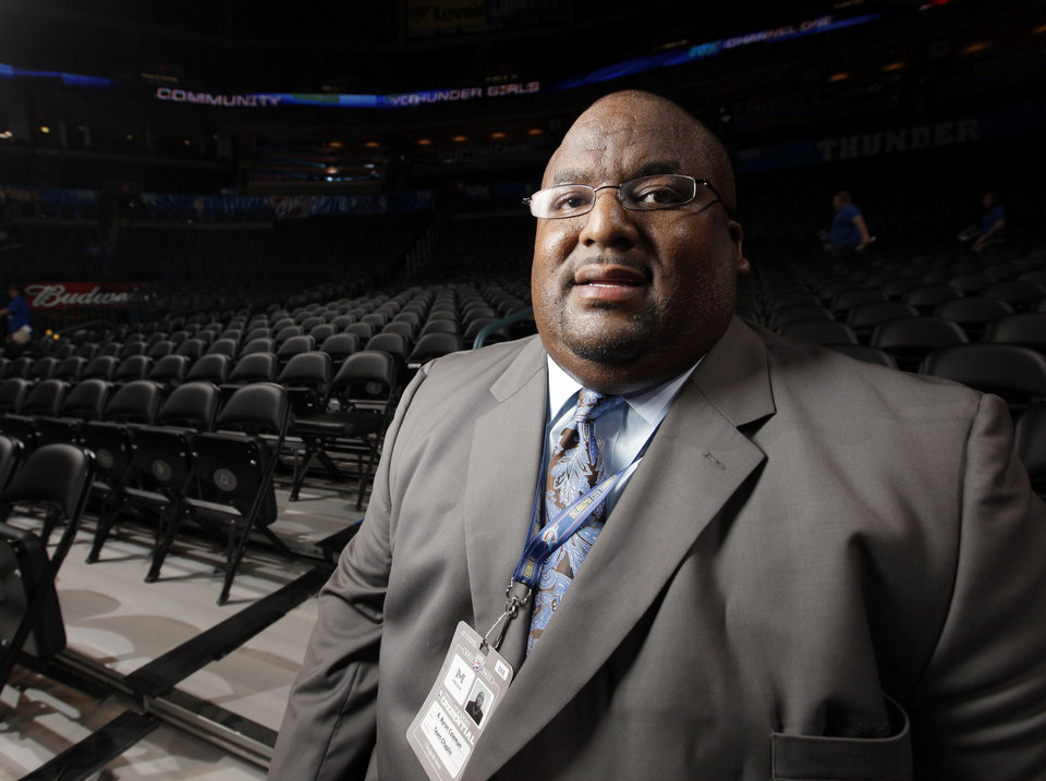 Photo - Rev. A. Byron Coleman III, Thunder team chaplain, poses for a photo before the NBA basketball game between the Memphis Grizzlies and the Oklahoma City Thunder at Chesapeake Energy Arena in Oklahoma City, Monday, April 2, 2012. Photo by Nate Billings, The Oklahoman