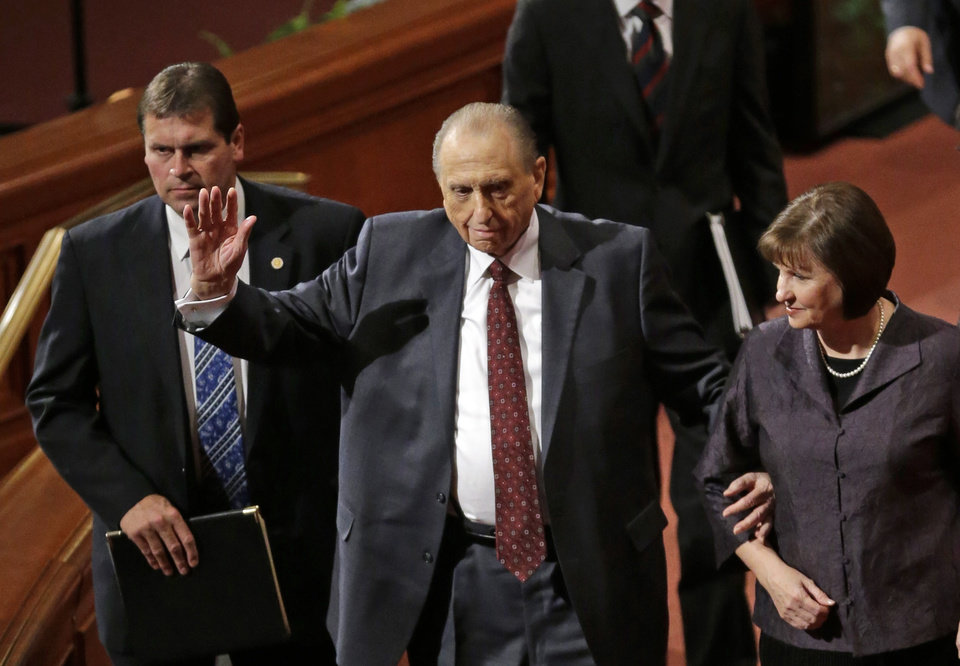 Photo - President Thomas S Monson, center, and his daughter, Ann Dibb walk off following the morning session of the 183rd Semiannual General Conference for the Church of Jesus Christ of Latter-day Saints Saturday, Oct. 5, 2013, in Salt Lake City. The president of the Mormon church says worldwide membership has hit 15 million, representing a three-fold increase over the three decades. Monson announced the milestone during the opening session of the two-day Mormon church conference Saturday morning. The biannual general conference of The Church of Jesus Christ and Latter-day Saints brings 100,000 members to Salt Lake City. More than half of church members live outside of the United States. (AP Photo/Rick Bowmer)