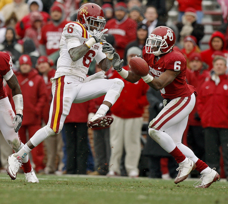 Photo - Oklahoma's Demontre Hurst (6) helps defend Iowa State's Darius Darks (6) during a college football game between the University of Oklahoma Sooners (OU) and the Iowa State University Cyclones (ISU) at Gaylord Family-Oklahoma Memorial Stadium in Norman, Okla., Saturday, Nov. 26, 2011. Photo by Bryan Terry, The Oklahoman