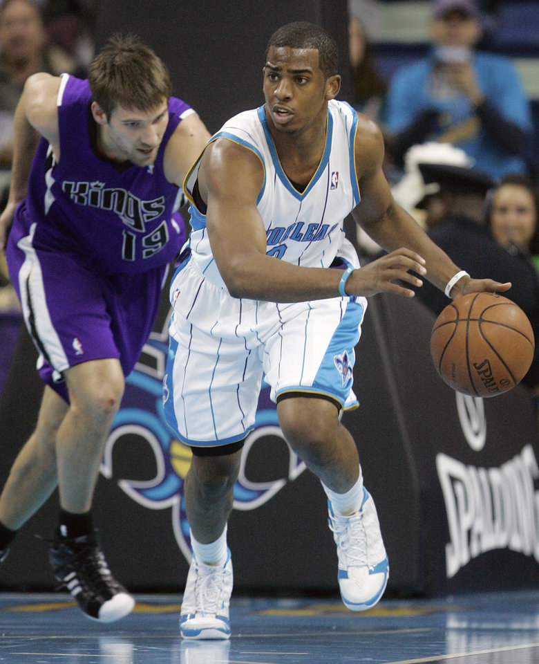 Photo - New Orleans Hornets guard Chris Paul (3) starts the fast break in front of Sacramento Kings guard Beno Udrih (19), of Slovenia,  in the first half of their NBA basketball game in New Orleans, Wednesday, Nov. 19, 2008.  (AP Photo/Bill Haber) ORG XMIT: LAWH103