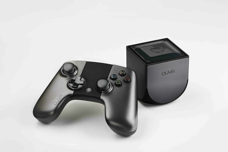 Photo - This photo provided by Ouya shows an Ouya, the Android-based video game console that aims to challenge the dominance of the Xboxes, Nintendos and PlayStations of the world. The console goes on sale Tuesday, June 25, 2013. (AP Photo/Ouya) ORG XMIT: NY123