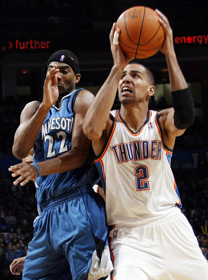 Photo - Oklahoma City's Thabo Sefolosha (2) tries to get the ball past Corey Brewer (22) of Minnesota during the NBA basketball game between the Minnesota Timberwolves and the Oklahoma City Thunder at the Oklahoma City Arena, Monday, November 22, 2010, in Oklahoma City. Photo by Nate Billings, The Oklahoman