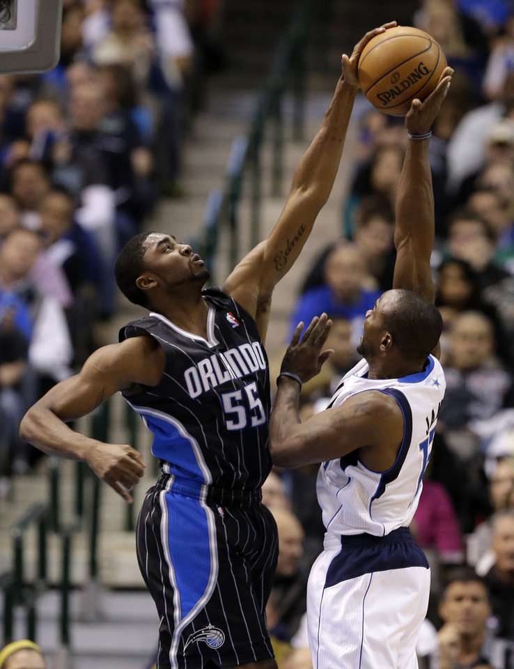 Orlando Magic's E'Twaun Moore (55) blocks a shot attempt by Dallas Mavericks' Mike James in the first half of an NBA basketball game Wednesday, Feb. 20, 2013, in Dallas. (AP Photo/Tony Gutierrez)