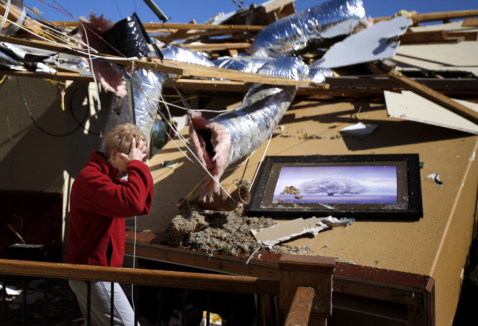 Carole Beckett reacts as she sorts through belongings at her home after a tornado moved through Woodward, Okla., Sunday, April 15, 2012. Photo by Bryan Terry, The Oklahoman