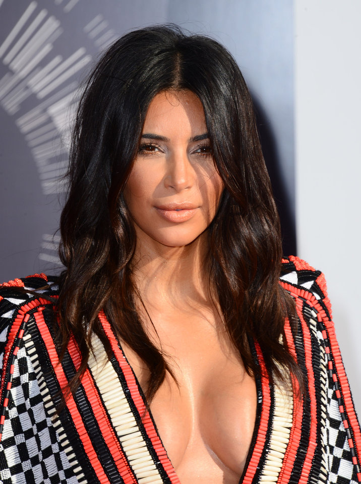 Photo - Kim Kardashian arrives at the MTV Video Music Awards at The Forum on Sunday, Aug. 24, 2014, in Inglewood, Calif. (Photo by Jordan Strauss/Invision/AP)