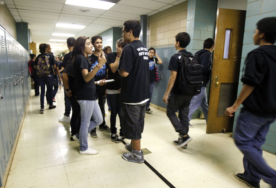 Photo - Students congregate in the hallway between classes at Webster Middle School in Oklahoma City, OK, Friday, May 4, 2012. This is for a story about the life of a middle school.  By Paul Hellstern, The Oklahoman