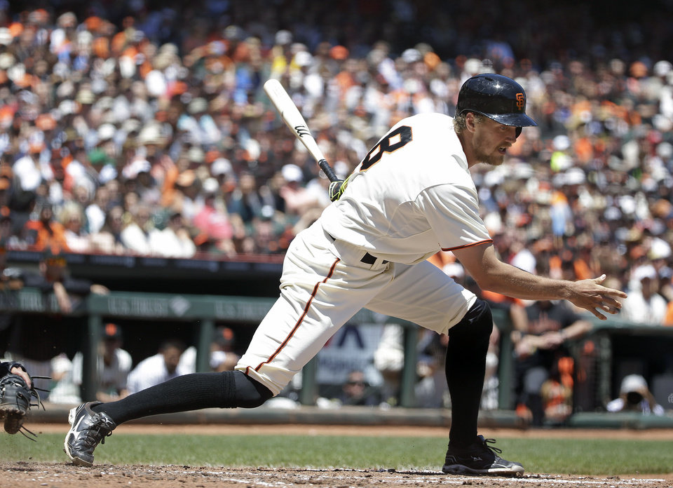 Photo - San Francisco Giants' Hunter Pence strikes out swinging against St. Louis Cardinals starting pitcher Carlos Martinez in the third inning of their baseball game Thursday, July 3, 2014, in San Francisco. (AP Photo/Eric Risberg)